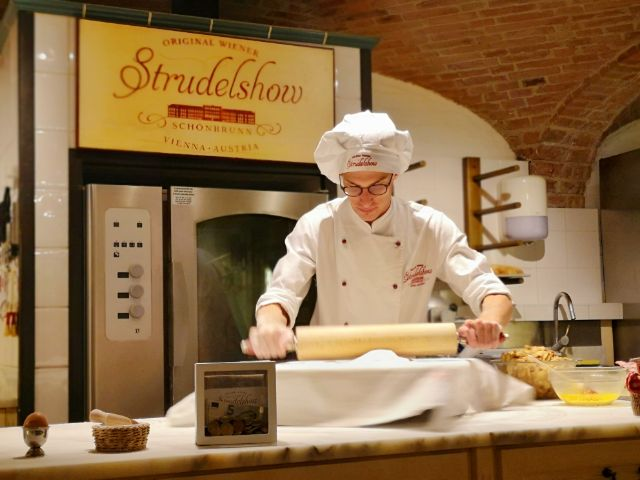 Rolling out the dough for the apple strudel at the Vienna Strudel Show