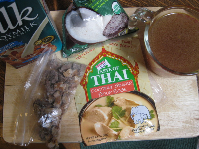 soymilk, coconut, homemade (!) veggie broth, frozen work mystery meat from a while bag, coconut-ginger soup base