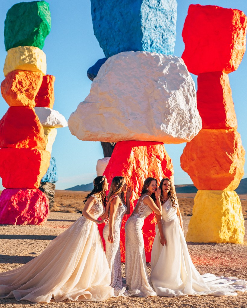 7 magic mountains with 4 women in wedding dresses