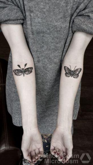 tattoo borboleta dois braços