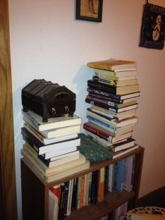 My to-read pile near the bed.