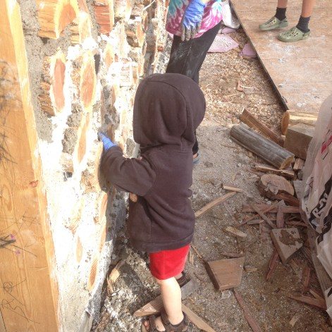 Helping with cordwood