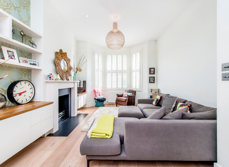 Modern Living Room With Sunburst Mirror
