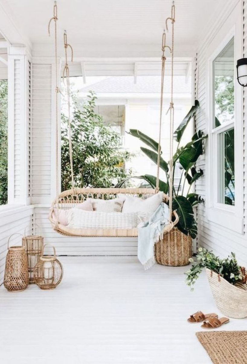 Tropical Patio With A Rattan Hanging Daybed