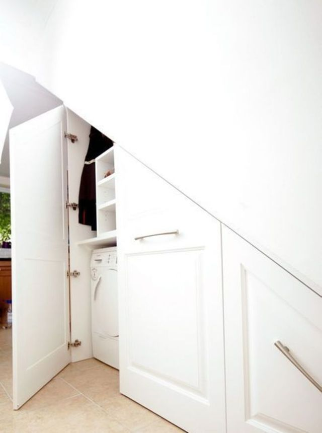 A Built In Laundry Space Under The Stairs