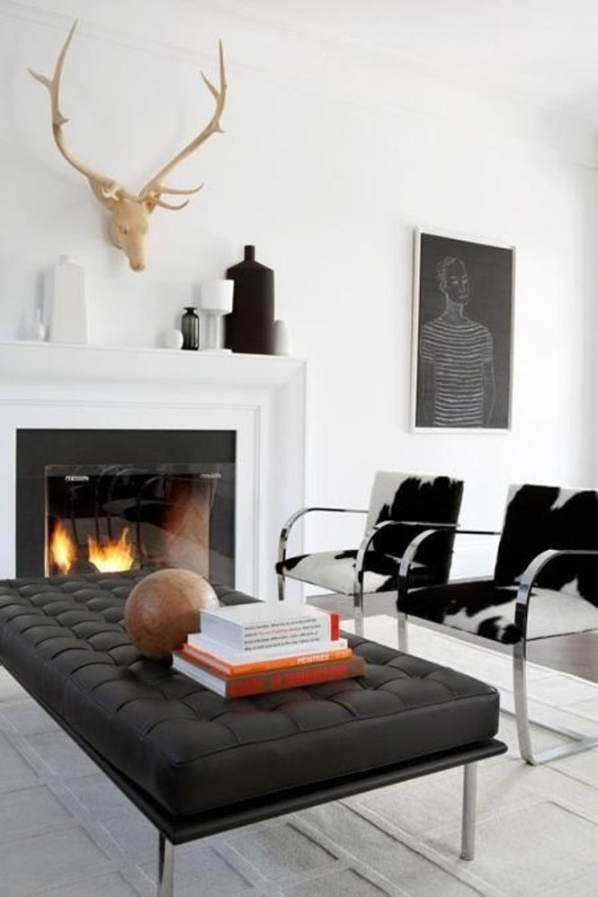 An Elegant Minimalist Living Room With A Fireplace