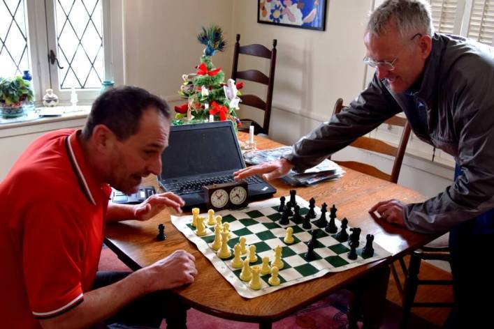 """Recreating 1980 match, Webster v. Brighton. """"Dave Kramer of Brighton concentrates on his next move. He lost."""" [Photo: Rebecca Ghyzel, 12/26/18]"""