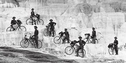 During their 1896 excursion from Fort Missoula, Mont., to Yellowstone National Park, riders of the 25th Infantry Bicycle Corps, led by 2nd Lt. James A. Moss, at top, pose on Minerva Terrace at Mammoth Hot Springs.