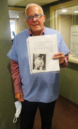 Dr. Bob Bryant with a copy of the autograph