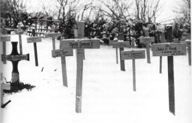 Crosses mark the graves of American and German soldiers killed early in the Battle of the Bulge. See The Bulge and Rochester seventy-four years later