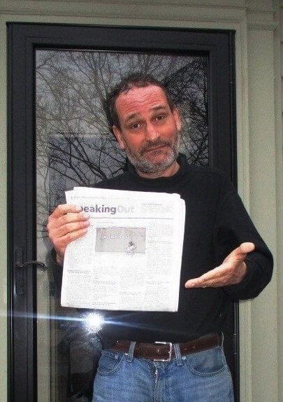 David Kramer holding the ever vanishing Speaking Out section of the Rochester Democrat and Chronicle, 1/15/19