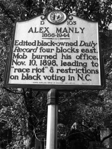 State-highway-historical-marker-for-African-American-newspaper-editor-Alex-Manley-US