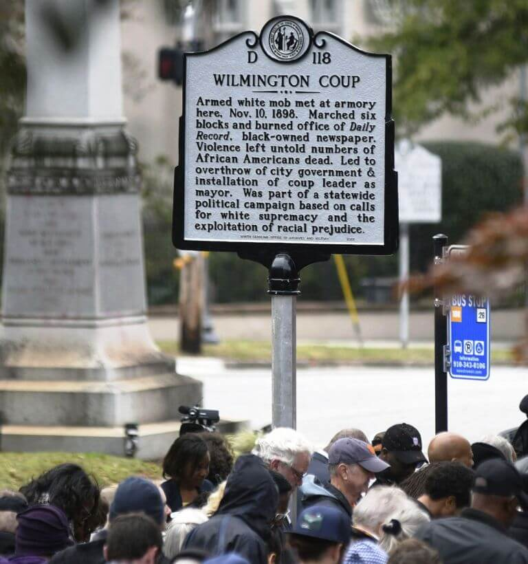 People stand under the new North Carolina highway historical marker to the 1898 Wilmington Coup during a dedication ceremony in Wilmington, N.C., Friday, Nov. 8, 2019. The marker stands outside the Wilmington Light Infantry building, the location where in 1898, white Democrats violently overthrew the fusion government of legitimately elected blacks and white Republicans in Wilmington. (Matt Born/The Star-News via AP) Rochester, NY 14618 585 244 2505 What has been missing from the impeachment debates over Trump's Ukraine policy is how bad a deal maker Trump really is. Trump rightfully said it was in the national interest to tie military aid to the Ukraine based on its progress to eliminate corruption and possible election tampering. On September 13th, 2019, Ukraine's President Zelenzky was prepared to announce in a CNN interview that his government would investigate whether the hacking of the DNC server originated in Ukraine and whether Burisma, the Ukrainian energy company that paid Hunter Biden $50,000 a month to be a board member, was guilty of corrupt practices.