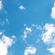 An image of the blue, cloudy sky in summer to represent Summer SAD a Talking-Cure offering support to those struggling with depression, anxiety, SAD and other mental health issues in Bolton