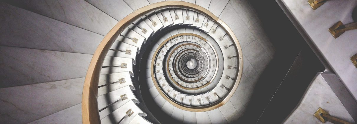 An image of a staircase to represent Talking-Cure offering Hypnotherapy and Psychotherapy to those struggling with mental health issues in Bolton