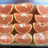 A four-by-three array of quarter grapefruit
