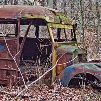 A broken down bus with no wheels
