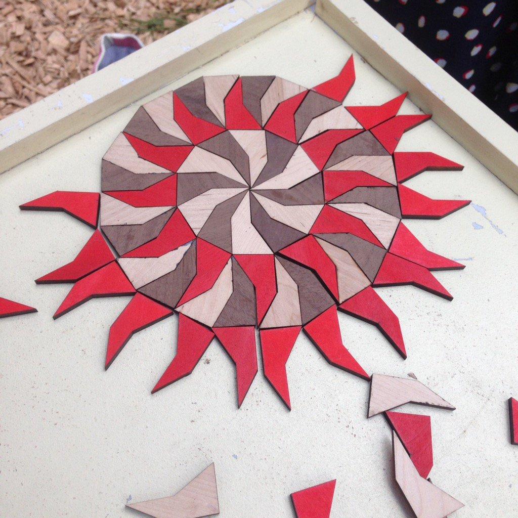 Red, brown, and tan pentagonal tiles
