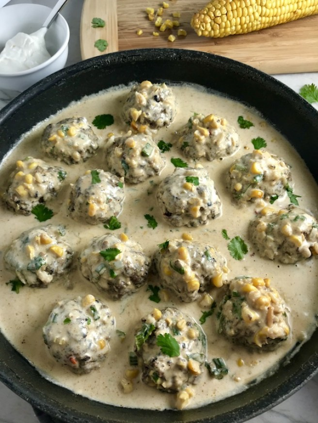 Chipotle Meatballs with Mexican Corn Cream Sauce are delicious! The meatballs are made with Chipotle peppers in adobo sauce, black beans, and scallion and are baked to perfection. The creamy sauce is inspired by Mexican Street Corn with sweet corn, smokey Mexican spices, cool and tangy sour cream.