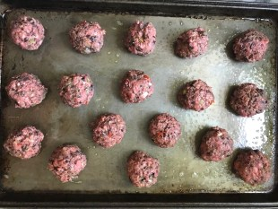 Raw meatballs on a pan for Chipotle Meatballs with Mexican Corn Cream Sauce
