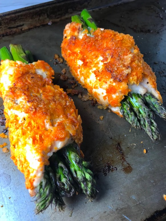 DORITO-CRUSTED-CHICKEN and Asparagus Rolls!  Yes, Doritos, my friend.  The Doritos add a salty and crispy crust to the outside of the chicken with a hint of cheesy flavor.  The Chicken stays moist and juicy rolled up and you get this fresh bite of Spring in the center with the Asparagus.