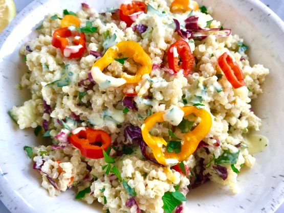 Veggie Quinoa Salad with Creamy Lemon Dressing is loaded with flavor, texture, color and is both delicious and nutritious! This Quinoa Veggie Salad has cucumber, sweet peppers, radicchio, scallions, and parsley. The dressing is a bright Creamy Lemon Dressing with Lemon, honey, mustard, and sour cream.