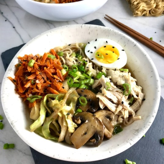 Rockin' Ramen Noodles with Chicken have flavorful broth, hearty chicken, crunchy veggies, creamy egg, sesame seeds & scallions.  Gluten-Free too!