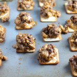 Hanky Panky Canapes cooked on sheet pan. These Hanky Panky Canapes are the BEST Party Appetizers around!  They cheesy, meaty, and absolutely delicious.  Ground Beef is mixed with Homemade Chicken Sausage and then combined with lots of cheese until its a creamy addictive pot of goodness.  Then it is scooped on top of bread, toasts, or crackers
