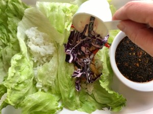 Adding cabbage to Lettuce leaves for Asian Lettuce Wraps. They are a fantastic way to use leftover Turkey or Chicken transforming it with new delicious flavors and textures. The turkey is stir fried with carrots, red pepper, and brussel sprouts in a flavorful ginger, garlic, & sesame sauce. It's layered in lettuce wraps with rice and a cool, crunchy purple cabbage sesame slaw. Serve with a Garlic Honey Soy Sauce....YUM!!!