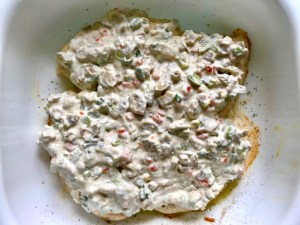 Sauce on Chicken in pan for the Creamy Olive Chicken recipe.  This is magnificently thick and creamy and infused with garlic flavor and nuttiness from the Parmesan. The best part; however, is the salty and briny flavor kick from the green olives with a little sweetness from the pimiento. #chicken #chickenrecipes #chickendinner #easydinners #easyrecipes #comfortfood #casserole