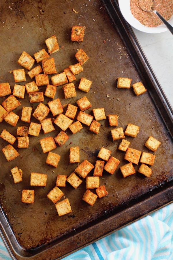 Roasted Tofu Croutons on pan. These are seasoned and toasted for the perfect addition to any salad, pasta, rice, or soup!   They get a roasted, almost nutty flavor with a salty and smoky seasoned crust with a chewy bite.  Super easy to make, low carb and great source of protein!  #croutons #salad #tofu #tofurecipes #vegetarian #plantbased #paleo
