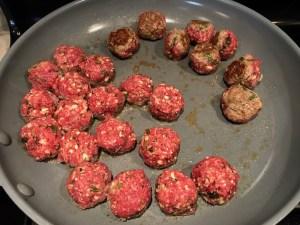 Flipping meatballs over in skillet for Meatballs in Cauliflower Dill Cream Sauce. #meatballs #swedishmeatballs #familydinner #easydinner #dinner #healthydinner