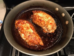Cooked Chicken in skillet for Sesame Sweet Chili Chicken recipe. It is slightly sweet, tangy, savory, nutty, with a touch of heat. You can prepare it days ahead, it takes just minutes to prepare, minutes to cook, and everyone will love it!! #chicken #marinades #easydinner #easychicken #chickenrecipes #easysauces #healthydinner #healthyfood #healthyrecipes