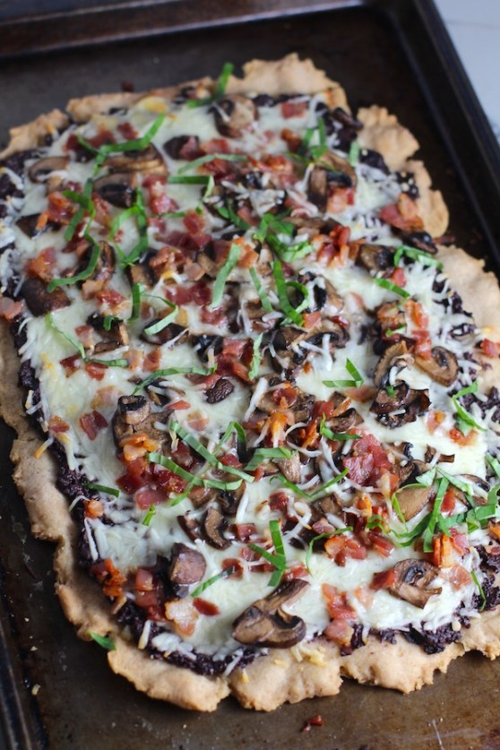 Flatbread with crispy gluten free crust, salty and briny Olive Tapenade, creamy mozzarella, earthy and meaty mushrooms, peppery pancetta, and fresh basil. #flatbread #pizza #olives #tapenade #mediterranean #easydinner #dinner