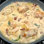 Skillet Artichoke Chicken with sun dried tomatoes, basil, garlic, in cream sauce. #skilletchicken #skilletdinner #chicken #easydinner #familydinner #italian #tuscanchicken