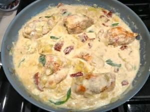 Skillet Artichoke Chicken with sun dried tomatoes, basil, garlic, in cream sauce.#skilletchicken #skilletdinner #chicken #easydinner #familydinner #italian #tuscanchicken