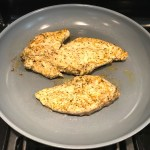 Mediterranean Chicken Cooking in a skillet. This Mediterranean Marinade is only a few ingredients, can be made ahead, and is delicious!