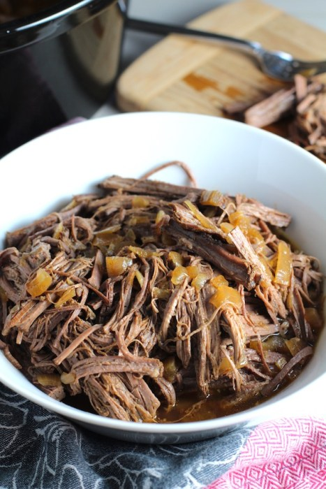 Pulled Beef Brisket in a bowl and in the Slow Cooker is smokey, savory, tender, moist, and full of flavor. In a delicious sauce, it goes great on a sandwich, over polenta, on rice, or potatoes. #slowcooker #crockpot #brisket #beefbrisket #pulledbeef #pulledpork