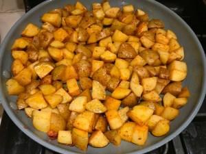 Potatoes in skillet for Patatas Bravas with chorizo and creamy Paprika aioli. This Patatas Bravas Recipe, or Spicy Potatoes, is easy, indulgent, and utterly delicious! #potatorecipes #potatoes #potatosidedishes #patatasbravas #skilletpotatoes #sidedishes #chorizo