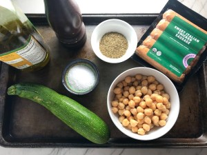 Ingredients for Mediterranean SHEET PAN DINNER with chicken sausage, parmesan zucchini. and crispy chickpeas. Serve over quinoa with dollops of seasoned Ricotta. #sheetpandinner #chickpeas