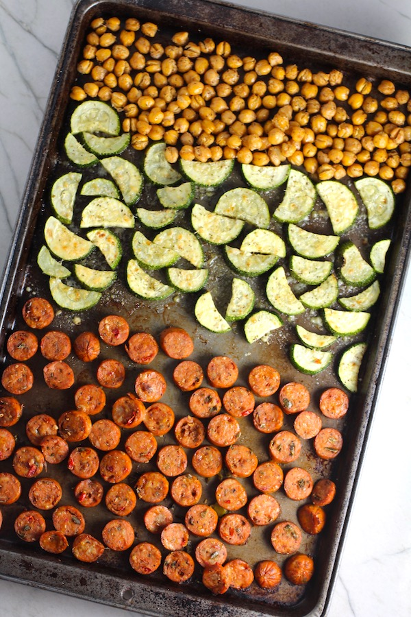 Mediterranean SHEET PAN DINNER with chicken sausage, parmesan zucchini. and crispy chickpeas. Serve over quinoa with dollops of seasoned Ricotta. #sheetpandinner #chickpeas