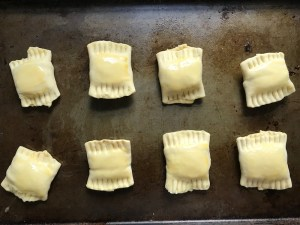Uncooked Mini Beef Wellington Bites on pan. They are flaky and buttery Puff Pastry is filled with a creamy mushroom and parmesan filling and tender beef filet.  #appetizers #partyfood