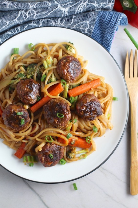 Teriyaki Meatballs with Veggie Stir Fry, and rice noodles on a plate.  #asianmeatballs #teriyaki #noodles #familydinner #easydinners #dinnerideas