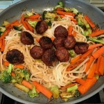 Carrots, broccoli, cabbage, noodles, & meatballs in pan for Teriyaki Meatballs with Veggie Stir Fry, and rice noodles. #asianmeatballs #teriyaki #noodles #familydinner #easydinners #dinnerideas