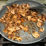 Seared sliced Mushrooms in skillet for this Heavenly Mushroom Sauce Recipe. #vegetarian #healthydinner #dinnerideas #mushrooms