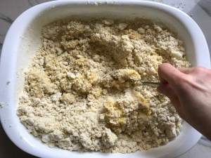 Mixing egg into cauliflower gnocchi dough in dish for Cauliflower Gnocchi, which are soft, silky, buttery, and melt-in-your-mouth! Made with cauliflower, they're a healthier version to traditional gnocchi! Add my simple Garlic Butter Sauce or Tomato Sauce and they are heaven.  #dinnerideas #gnocchi #cauliflower
