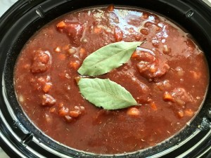 2 bay leaves on top of ingredients in pot for Shredded Beef Ragu Recipe with Pappardelle. It's so easy to make and has a thick meaty texture and a super rich delicious flavor.