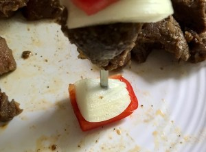 Putting skewer through onion and red pepper for Garlic Steak Kabobs. #beefkabobs #steakkabobs