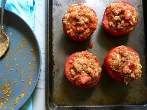4 Stuffed Tomatoes on sheet pan with chorizo, quinoa, parmesan cheese, chives, garlic, and oregano.