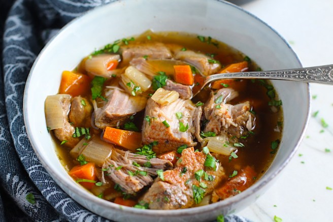 Paprika Pork Stew Recipe in a bowl with carrots, onion, parsley. It's an easy family dinner.
